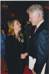 Michelle Tennant discusses SOS Children's Villages with Bill Clinton.